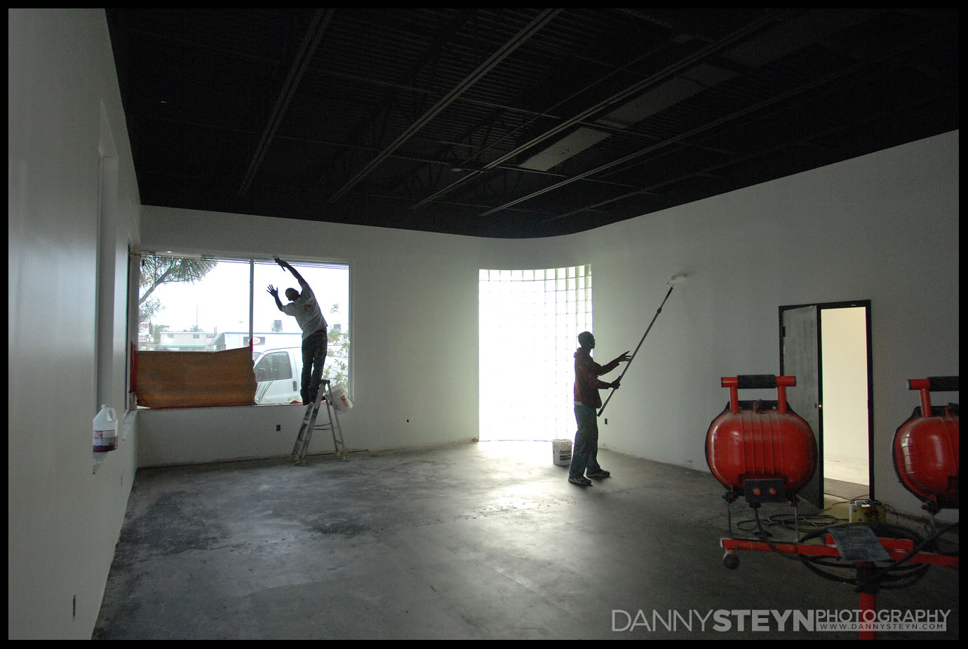 New Photography Studio construction - Studio walls and window frames being painted