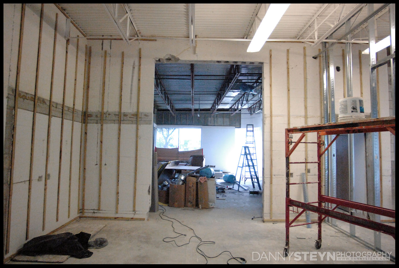 Furring strips for drywall going up in the Prop Room, looking into the Natural Light Studio