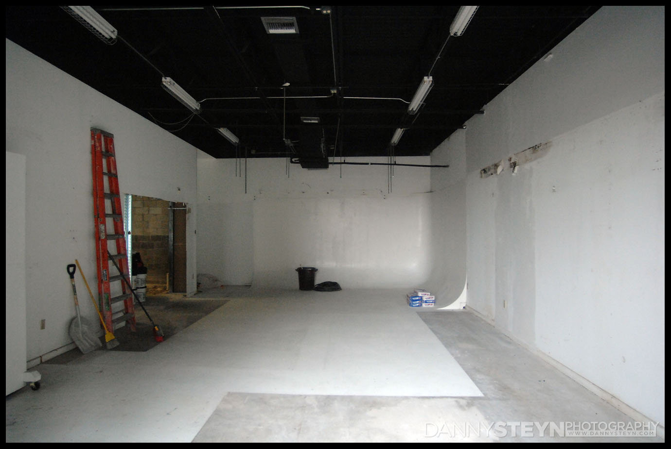 The empty main Portrait Studio with cyc wall and newly discovered leak and drywall rot!