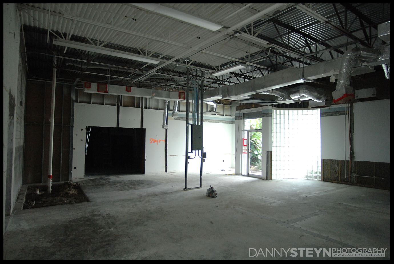 Front entrance, lobby, new bathroom and entry to the portrait studio visible in this empty space